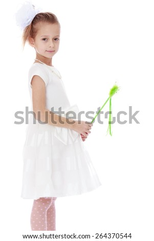 Girl in a white dress holding a magic wand - isolated on white background - stock photo