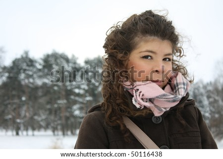 girl in winter park near fir trees in St-Petersburg - stock photo