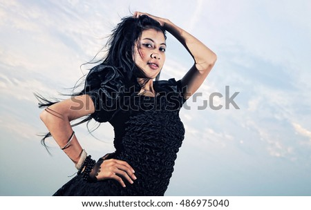 girl posing with a black dress