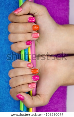 Girl's hands holding colored jelly candy