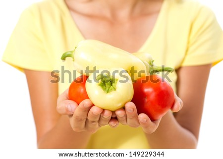 girl's hands with pepper and tomatoes