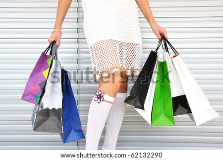 Girl with a bunch of shopping bags