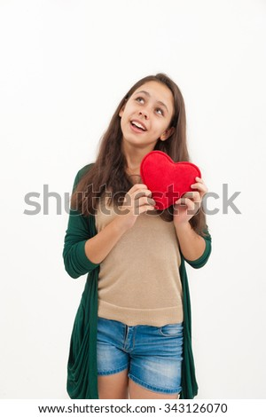 girl with a toy heart in hands