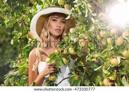 Girl with apples in the garden