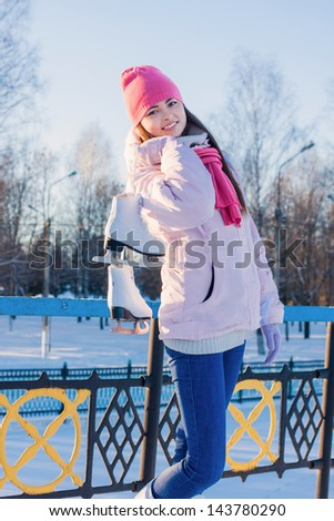 girl with ice skate outdoor - stock photo