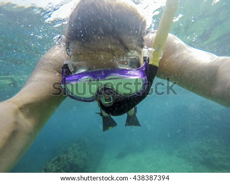 girl with mask exploring underwater in the Mediterranean