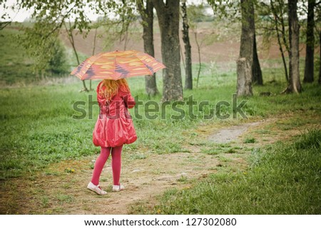 girl with umbrella outdoor - stock photo