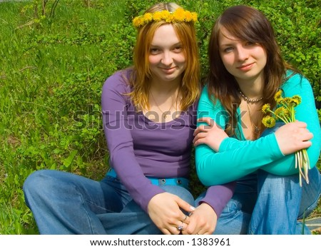 2 girls, one in a wreath, another with flowers