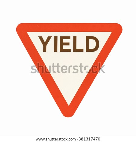Give way or yield traffic sign isolated vintage - stock photo