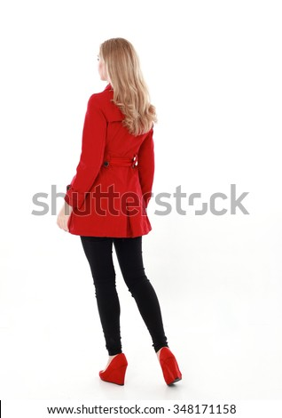 glamorous, beautiful blonde young woman with blonde hair, wearing  long, red winter trench coat.  full length standing portrait,  back view, walking away from camera. isolated on white background. - stock photo