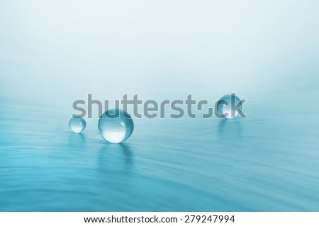 glass balls on a blue background - stock photo