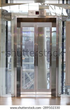 Glass elevator - stock photo