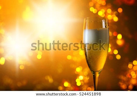 glass of champagne on a background of Christmas ornaments