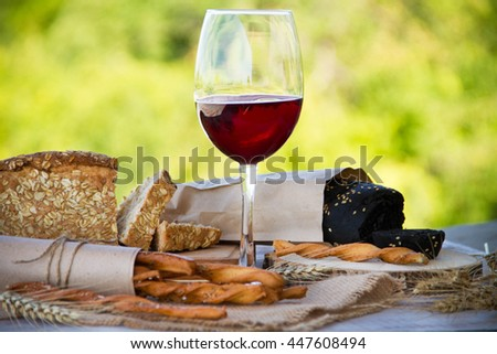 glass of rose wine with bread