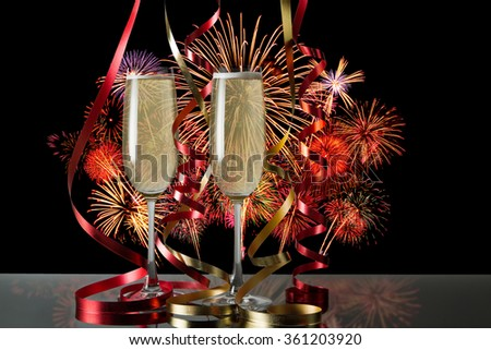 Glasses of champagne for celebrations with fire works background. - stock photo