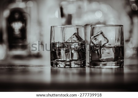 2 glasses of whiskey black and white - stock photo