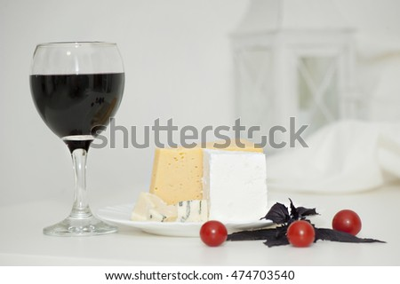 Glasses of wine and cheese. selective focus