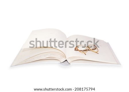 glasses on an opened  book. - stock photo