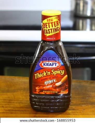 GLOUCESTER, VA - DECEMBER 26, 2013: Kraft Honey BBQ sauce. Kraft Foods Group Inc is an American grocery manufacturing and processing conglomerate headquartered in Northfield, Illinois.