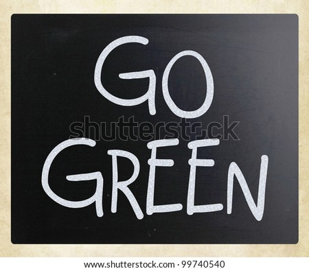 """Go green"" handwritten with white chalk on a blackboard"