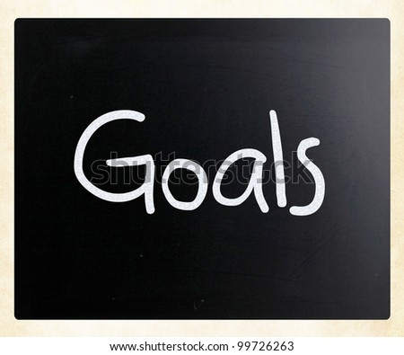 """Goals"" handwritten with white chalk on a blackboard"