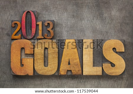 2013 goals - New Year resolution concept - text in vintage letterpress wood type blocks against grunge metal background - stock photo