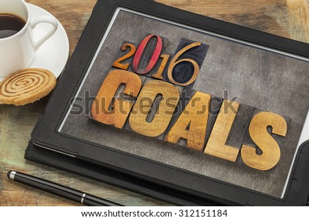 2016 goals - New Year resolution concept - text in vintage letterpress wood type on a digital tablet with a cup of coffee - stock photo