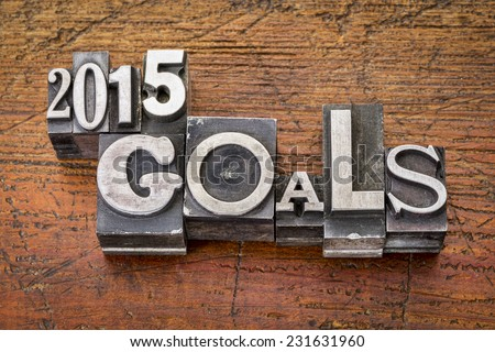 2015 goals - New Year resolution concept - text in vintage metal type blocks against grunge wood - stock photo