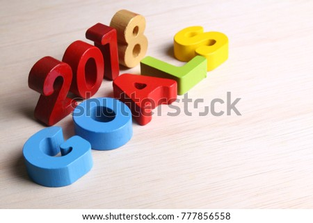 2018 goals on colorful blocks on wooden surface