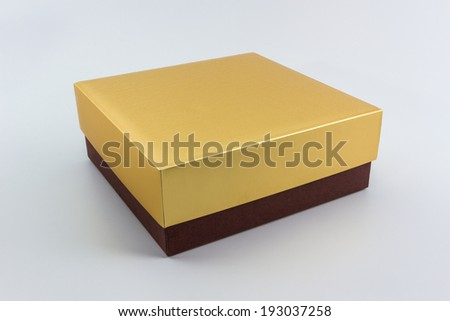 Gold and Brown box on white backgorund  - stock photo