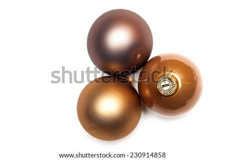3 gold christmas holiday ornaments on a white background - stock photo