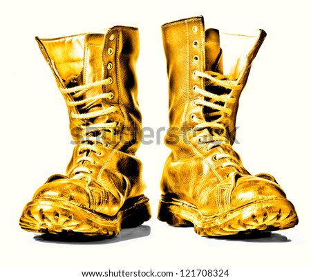 golden  combat boots isolated on white background - stock photo
