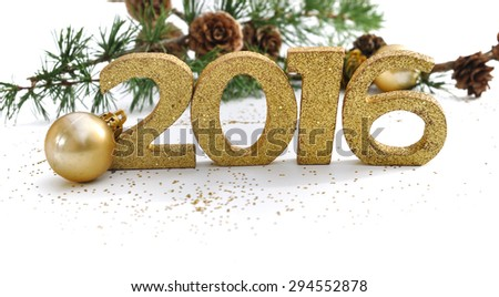 2016 golden digits with fir branches on a white background - stock photo