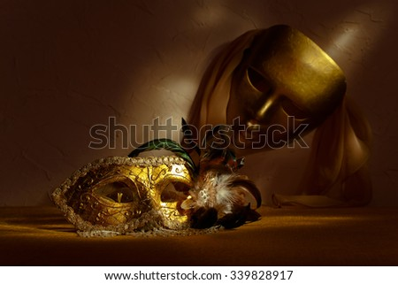 golden Venetian masks , focus on a foreground