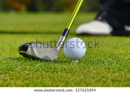 Golf Ball and Club, Man playing golf - stock photo