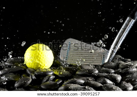 Golf club and  yellow ball on black background - stock photo
