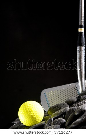 Golf club and  yellow ball on black background