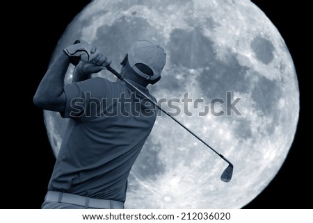 golf swing and a big moon - stock photo
