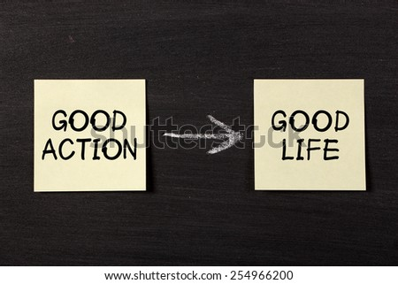 'Good Action Results Good Life' concept on black chalkboard.
