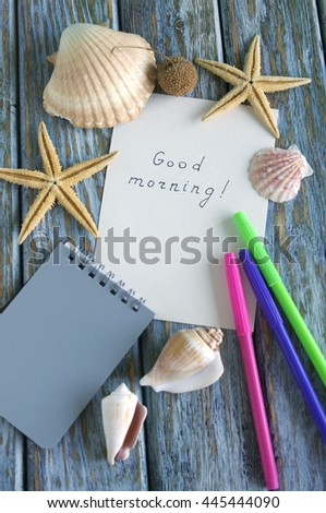 """Good morning"" is written on small paper and rustic wood background"