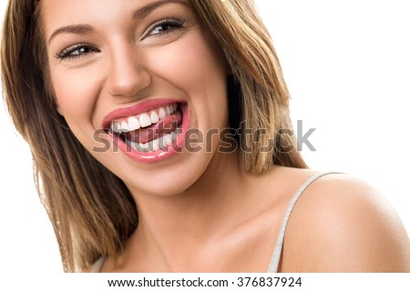 Gorgeous woman with beautiful, healthy  teeth smile  - stock photo