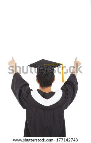 graduation man wearing a mortarboard and raised hands