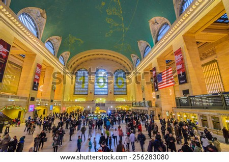 [2013-12-28] Grand Central Terminal, New York City which was first build in 1871. This is the largest subway terminal by number of platforms. Station building and passengers are in the photo.  - stock photo