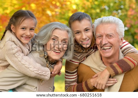 grandfather, grandmother  and grandchildren in park