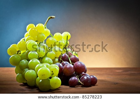 ,grape white and black on wood, 	 - stock photo