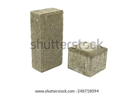 gray decorative street pavement concrete bricks paving stone isolated on white background - stock photo