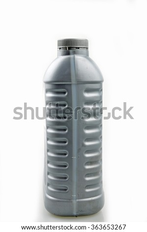 Gray lubricating oil bottle isolated on a white background