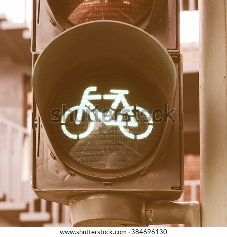 Green light for bycicle lane on a traffic light vintage