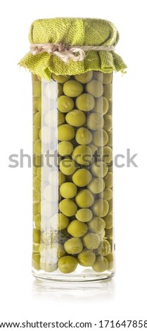 Green peas preserved in glass jar isolated on white background - stock photo
