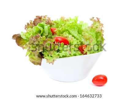 green salad with cherry tomatoes in a bowl
